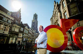 Christian Prudhomme, general director of the Tour de France, poses in the center of Utrecht, The Netherlands on July 1, 2015 prior to the start of the Tour de France cycling race on July 4.