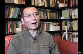 FILE - Liu Xiaobo speaks during an interview in his home in Beijing, China, Jan 6, 2008, in an image taken from video footage by AP Video. According to a statement July 7, 2017, the Chinese medical team charged with treating the imprisoned Nobel Peac
