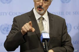 Syrian Ambassador to the United Nations Bashar Ja'afari speaks to reporters after a meeting about Syria at United Nations headquarters, New York, Aug. 28, 2013.