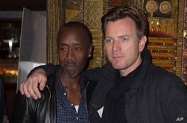 "Actor and director Don Cheadle, left, poses for photographers with fellow actor Ewan McGregor at the screening of ""Miles Ahead,"" in London, April 5, 2016."