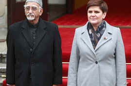 Polish Prime Minister Beata Szydlo, right, receives Indian Vice-President Mohammad Hamid Ansari during a welcome ceremony in front of the Office of the Prime Minister in Warsaw, Poland, April 27, 2017.