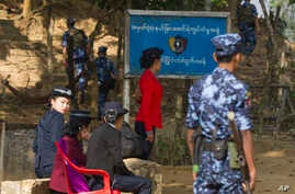 Myanmar police officers provide security at the border crossing near Taungbro bridge, Jan. 24, 2018, in Taungpyo township, Maung Daw district, border town of northern Rakhine State.