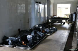 Bodies are seen inside the Institute of Forensic Science during a police strike in Vitoria, Espirito Santo, Brazil, Feb. 7, 2017.