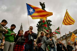 People wave pro-independence flags during a rally in support for the secession of the Catalonia region from Spain, in Vitoria, northern Spain, Sept. 9, 2017.