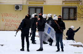 Turkish riot police secure the area outside the pro-Kurdish Democratic Regions Party (DBP) headquarters in the southeastern city of Diyarbakir, Turkey, Jan. 5, 2016.