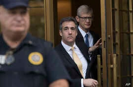 President Donald Trump's former attorney Michael Cohen (C) leaves Federal court, Aug. 21, 2018, in New York.