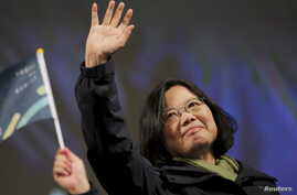 Democratic Progressive Party (DPP) Chairperson and presidential candidate Tsai Ing-wen waves to supporters as they celebrate her election victory at the party's headquarters in Taipei, Taiwan, Jan. 16, 2016.