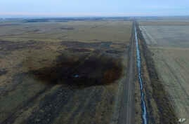 This aerial photo shows spills from TransCanada Corp.'s Keystone pipeline, Nov. 17, 2017, that leaked an estimated 210,000 gallons of oil onto agricultural land in northeastern South Dakota, near Amherst, South Dakota.