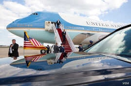 FILE - President Barack Obama disembarks Air Force One upon arrival at Joint Base Andrews, Md. .