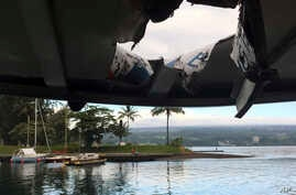 This photo provided by the Hawaii Department of Land and Natural Resources shows damage to the roof of a tour boat after an explosion sent lava flying through the roof off the Big Island of Hawaii, July 16, 2018.