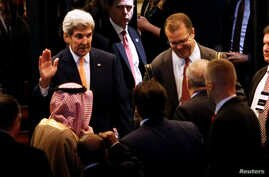 U.S. Secretary of State John Kerry waves toward Saudi Arabia's Foreign Minister Adel al-Jubeir, left, and Jordan's Foreign Minister Nasser Judeh after a round of Syria talks in Lausanne, Switzerland, Oct. 15, 2016. Before leaving Switzerland, Kerry s