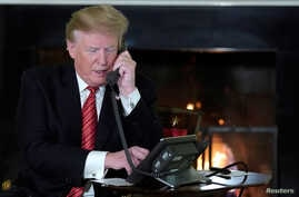 FILE - U.S. President Donald Trump conducts a phone call at the White House, in Washington, Dec. 24, 2018.