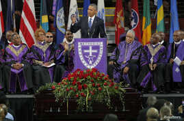 U.S. President Barack Obama speaks in front of the casket of Rev. Clementa Pinckney during funeral services for Pinckney in Charleston, South Carolina June 26, 2015.  Pinckney was one of nine victims of a mass shooting at the Emanuel African Methodis