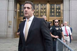 Michael Cohen leaves Federal court in New  York, Aug. 21, 2018.