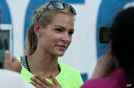 FILE - Russia's long jumper Darya Klishina speaks at the national track and field championship in Cheboksary, Russia.