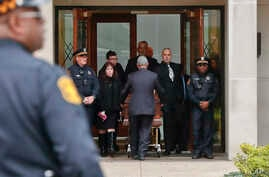 Pittsburgh police stand guard as the casket of Irving Younger, 69, is wheeled from Congregation Rodef Shalom after his funeral in Pittsburgh, Oct. 31, 2018.