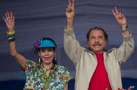 FILE - Nicaragua's President Daniel Ortega, right, and first lady Rosario Murillo, wave to supporters during an event commemorating the 36th anniversary of the Sandinista National Liberation Front withdrawal to Masaya, in Managua, Nicaragua, July 3,