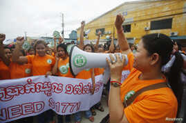 Garment workers shout during a protest calling for higher wages in Phnom Penh September 17, 2014. Cambodia deployed armed troops in its capital on Wednesday as garment workers held rallies to revive a campaign for higher wages that had helped to stok
