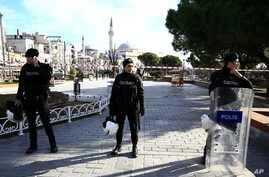 Policemen secure an area at the historic Sultanahmet district, which is popular with tourists, after an explosion in Istanbul, Tuesday, Jan. 12, 2016.