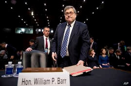 Attorney General nominee William Barr returns from a break in testimony at a Senate Judiciary Committee hearing on Capitol Hill in Washington, Jan. 15, 2019.