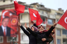 Supporters of Turkey's President Recep Tayyip Erdogan, waiting for his speech, wave Turkish flags, during a rally for the upcoming referendum, in his hometown city of Rize, in the Black Sea region of Turkey, April 3, 2017.
