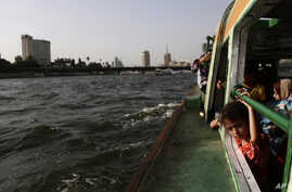 Egyptians enjoy a boat ride along the Nile River, in Cairo, Egypt, June 5, 2013.