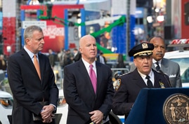 Chief of Patrol Carlos Gomez, right, gives a security briefing with Mayor Bill de Blasio, left, and Police Commissioner James O'Neill in Times Square, Nov. 7, 2016.