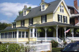 This is a small, but quaint Cape May Victorian home. Note the ruffled gingerbread trim.
