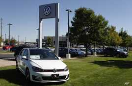 Volkswagens are on display on the lot of a VW dealership in Boulder, Colo., Sept. 24, 2015.