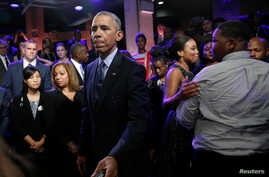 U.S. President Barack Obama meets members of the audience, including Cameron Sterling (R), son of Alton Sterling who was shot and killed by white police officers in Baton Rouge, after taking part in a televised town hall about trust and safety in our