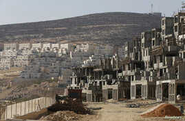 FILE - A construction site is seen in the West Bank Jewish settlement of Givat Zeev, near Jerusalem.