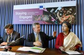 International Labor Organization (ILO) Director-General Guy Ryder (L), EU trade commissioner Karel De Gucht and Bangladeshi Foreign Minister Dipu Moni attend a meeting in Geneva with employee, industry and employer representatives focused on agreeing