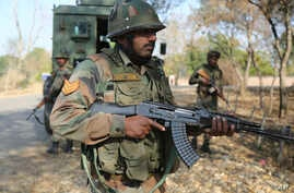 Indian army soldiers patrol during a search operation outside the camp of the General Engineering Reserve Force (GREF), the site of a militant attack, in the frontier Battal area, about 90 kilometers from Jammu, India, Jan. 9, 2017.