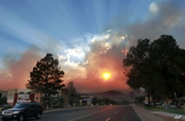 The sun shines through the smoke from the Las Conchas wildfire near the Los Alamos National Laboratory in Los Alamos, New Mexico, June 29, 2011