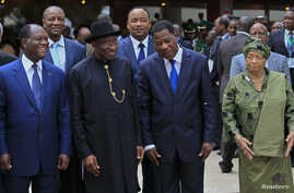 Ivory Coast's President Alassane Ouattara (L), Nigeria's President Goodluck Jonathan (2nd L), Benin's President Thomas Yayi Boni and Liberia President Ellen Johnson Sirleaf (R) are pictured at the 43rd Economic Community of West African States (ECOWA