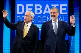 Chile Vamos candidate and former President Sebastian Pinera, left, and Nueva Mayoria or New Majority ruling party candidate Alejandro Guillier, pose for photos before the start of a live, televised presidential debate, in Santiago, Chile, Dec. 11, 20