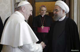 Iran's President Hassan Rouhani (R) is welcomed by Pope Francis at the Vatican, Jan. 26, 2016.
