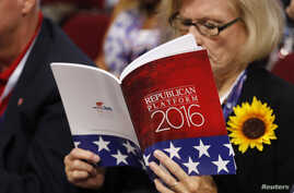 A delegate studies a copy of the Republican platform document that reflect the policies of the Republican Party that will be voted on at the RNC, at the Republican National Convention in Cleveland, Ohio, July 18, 2016.
