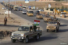 A convoy of Kurdish peshmerga fighters drives through Irbil after leaving a base in northern Iraq, on their way to Kobani, Syria, Oct. 28, 2014.