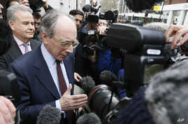 FILE - Former British Foreign Secretary Malcolm Rifkind speaks to the media in Westminster, London, Feb. 24, 2015.