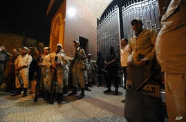 Egyptian security forces stand guard at a Coptic Christian church after gunmen opened fire, killing four people and wounding several others, in the Waraa neighborhood of Cairo late Sunday, Oct. 20, 2013.