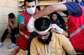 Medics treat civilians who were wounded at Raqqa's front line, at a mosque in Raqqa, Syria, Oct. 12, 2017.