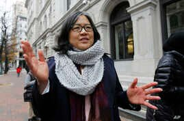Cecillia Wang, deputy legal director of the American Civil Liberties Union, answers questions outside the 4th U.S. Circuit Court of Appeals building in Richmond, Va., Dec. 8, 2017. The court listened to arguments Friday on the latest version of Presi