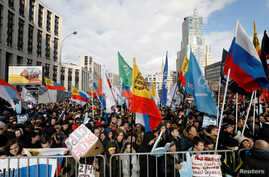 People attend a rally to protest against tightening state control over internet in Moscow, March 10, 2019.