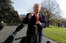 President Donald Trump talks with reporters before traveling to the G-20 Summit in Buenos Aires, on the South Lawn of the White House, Nov. 29, 2018, in Washington.