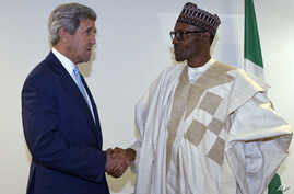 U.S. Secretary of State John Kerry, left, talks with newly inaugurated Nigerian President Muhammadu Buhari, before the start of a formal meeting in Abuja, Nigeria, May 29, 2015.