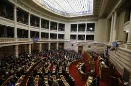 Greek lawmakers attend the third round of voting to elect a new Greek president at the Parliament in Athens, Dec. 29, 2014, as Greece heads to early general elections after parliament failed to elect a new president in a third and final round of voti
