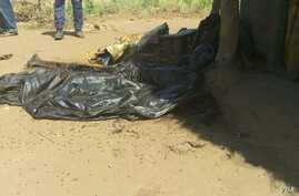 This photo, taken on or about April 12, 2017, shows the remains of a man slain during a raid on the town of Parjok, South Sudan, but men wearing uniforms of the South Sudanese army. Up to 16 people were killed, many of them execution-style. This man