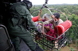 People are airlifted by the Indian Navy soldiers during a rescue operation at a flooded area in the southern state of Kerala, India, Aug. 17, 2018.