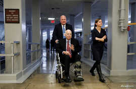 FILE - Sen. John McCain heads to the Senate floor ahead of votes on Capitol Hill in Washington, U.S., Dec. 6, 2017.